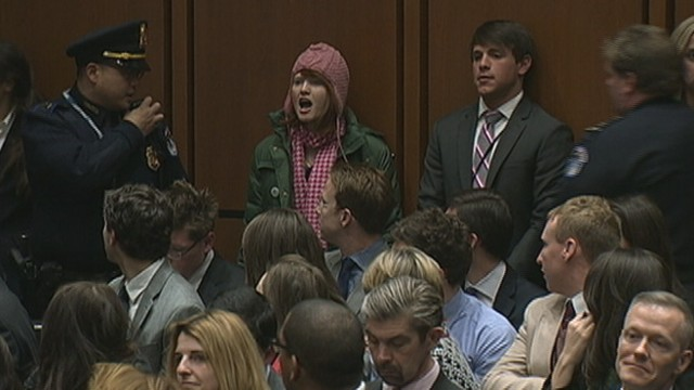 VIDEO: Woman shouting about the Middle East is escorted from room during senators testimony.