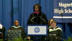VIDEO: The first lady encourages high school graduates to challenge themselves in order to find happiness.
