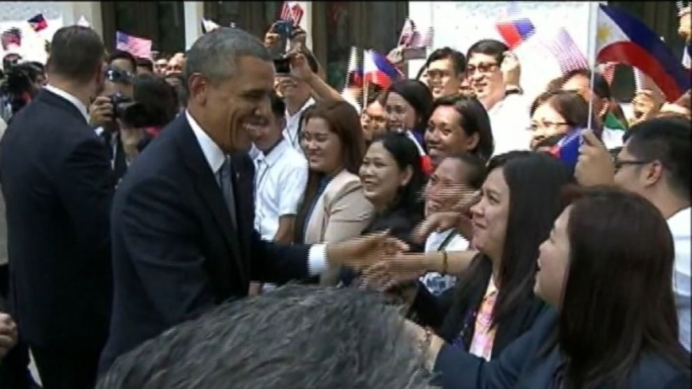 """VIDEO: President Obama shakes hands while """"Axel F"""" plays during his visit to the Philippines."""