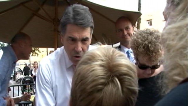 VIDEO: A woman in New Hampshire pushes her son to question Rick Perry about evolution.