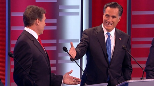 VIDEO: Rick Perry and Mitt Romney spar on health care.