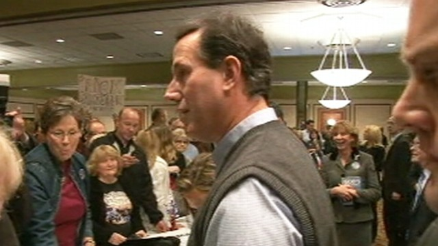 VIDEO: GOP candidate defends robo-call tactics against Mitt Romneys attacks.