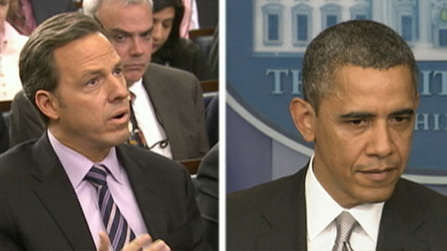 PHOTO: President Obama reacts to a question from ABCs Jake Tapper during a press briefing at the White House, Dec. 19. 2012.