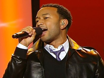 Picture of John Legend singing at the DNC.