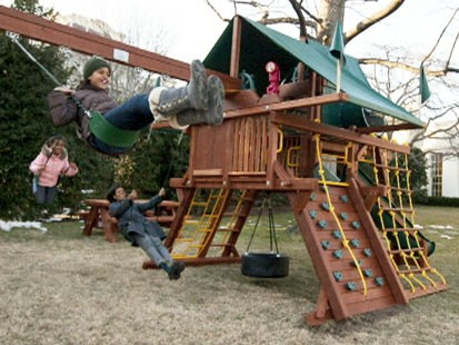 VIDEO: Sasha and Malia Obama get a new swing set.