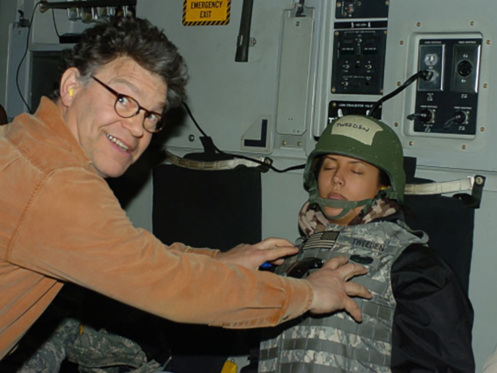 PHOTOGRAPH: Leeann Tweeden posted this online photo that she said was taken while she was sleeping on a return flight from a 2006 USO trip. She says it shows the then comedian Al Franken, who is now a US senator , that the palpa.