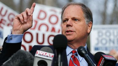 'PHOTO: Democratic candidate for U.S. Senate Doug Jones speaks to reporters after casting his ballot on Dec. 12, 2017, in Mountain Brook, Ala.' from the web at 'http://a.abcnews.com/images/Politics/alabama-election-04-ap-jc-171212_16x9t_384.jpg'