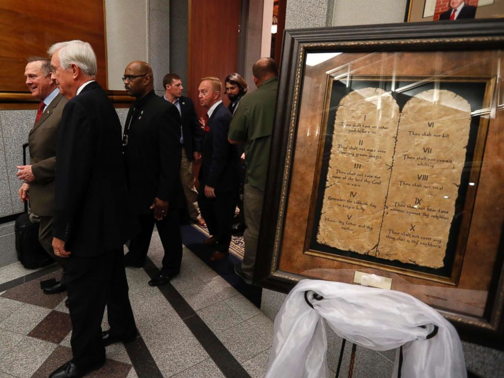 PHOTO: Republican Senate candidate Roy Moore passes by a display of the Ten Commandments as he arrives at his election night party in Montgomery, Ala., Dec. 12, 2017.