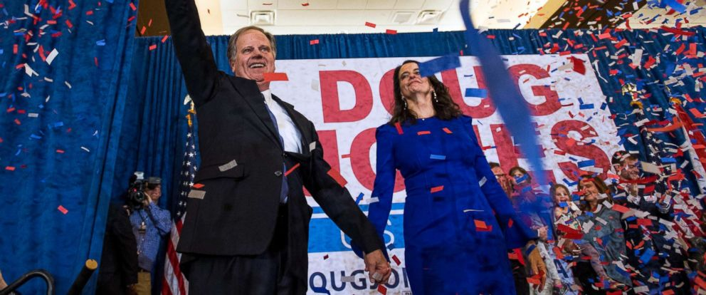 PHOTO: Senate candidate Doug Jones and his wife Louise greet supporters as he claims victory at his watch party in Birmingham, Ala., Dec. 12, 2017.