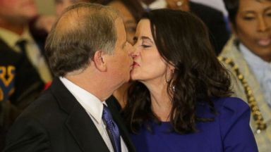 'PHOTO: Senate candidate Doug Jones kisses his wife Louise on their 25th anniversary1_b@b_1the election night party in Birmingham, Ala., Dec. 12, 2017.' from the web at 'http://a.abcnews.com/images/Politics/alabama-election-31-rtr-jc-171212_16x9t_384.jpg'