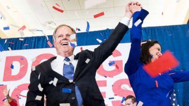 'PHOTO: Alabama Democrat Doug Jones celebrates his projected victory over Judge Roy Moore1_b@b_1the Sheraton in Birmingham, Ala., Dec. 12, 2017.' from the web at 'http://a.abcnews.com/images/Politics/alabama-election-37-nc-jc-171212_16x9t_384.jpg'