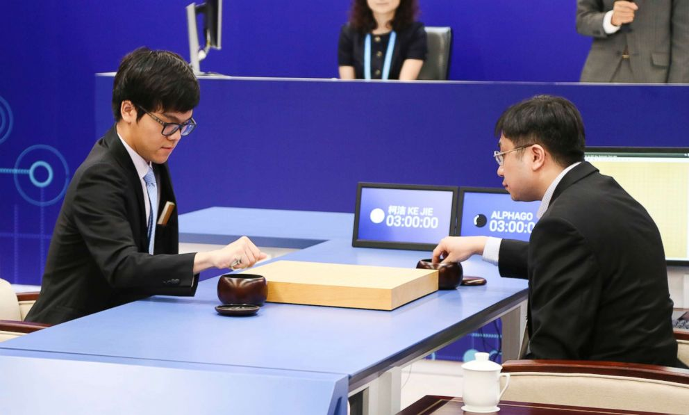 PHOTO: The Worlds top human player Ke Jie (L) competes against Googles artificial intelligence program AlphaGo during the Future of Go Summit at Wuzhen Town on May 23, 2017, in Jiaxing, Zhejiang Province of China.