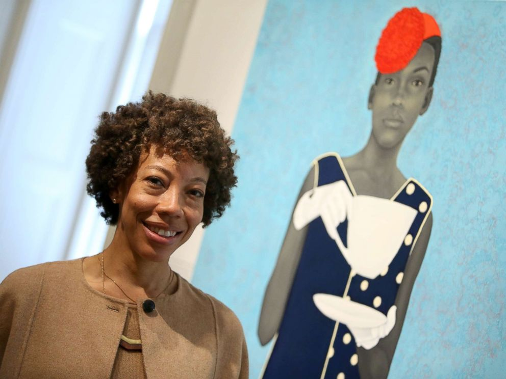 PHOTO: The Outwin Boochever Portrait Competition 2016 first prize winner, Amy Sherald, in front of her work, March 11, 2016, at the Smithsonians National Portrait Gallery in Washington.