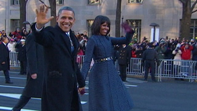 VIDEO: The first couple leaves presidential limousine to applause from crowds in Washington.