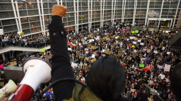 PHOTO: Seattle city councilwoman Kshama Sawant raises a fist over the crowd, as more than 1,000 people gather at Seattle-Tacoma International Airport, to protest President Donald Trump's order that restricts immigration to the U.S., Jan. 28, 2017.