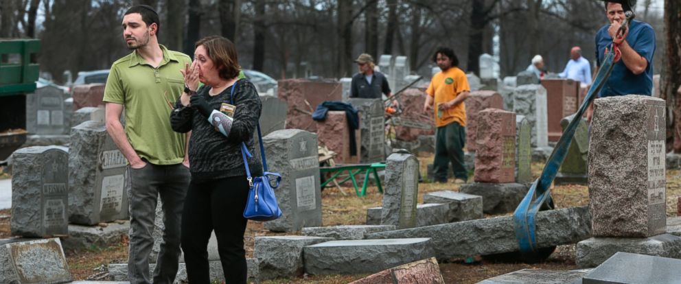 PHOTO: Sally Amon and her son Max Amon of Olivette, Missouri, react at the toppled gravestone of her grandmother Anna Ida Hutkin at Chesed Shel Emeth Cemetery in University City, a suburb of St. Louis, Feb. 21, 2017.