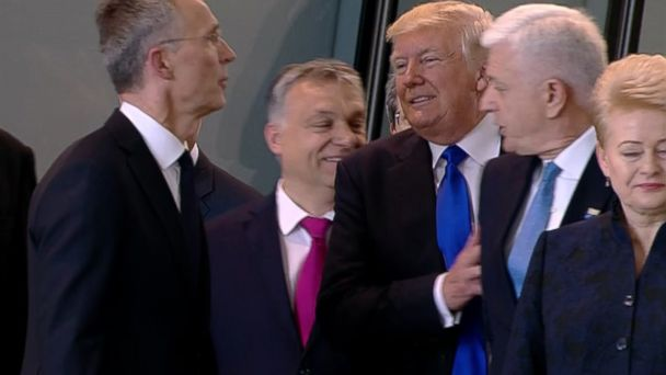 PHOTO: Montenegro Prime Minister Dusko Markovic appears to be pushed by President Donald Trump as they were given a tour of NATO's new headquarters during a NATO summit of heads of state and government in Brussels on May 25, 2017.