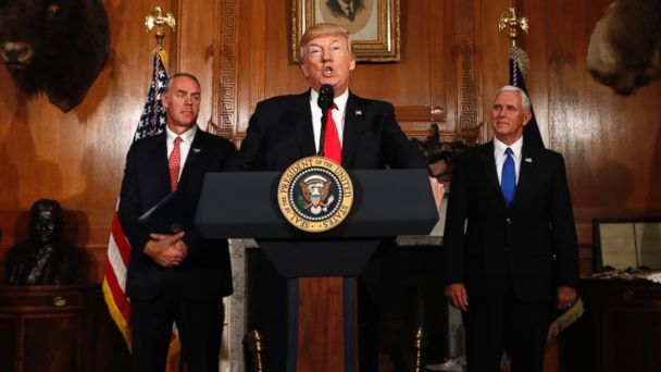 PHOTO: President Donald Trump, flanked by Interior Secretary Ryan Zinke, left, and Vice President Mike Pence, speaks at the Interior Department in Washington, April 26, 2017, before  signing an Antiquities Executive Order.