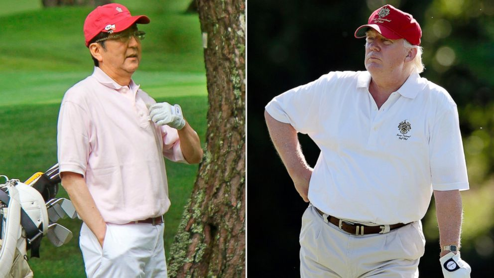 Trump, Abe bond over golf hats