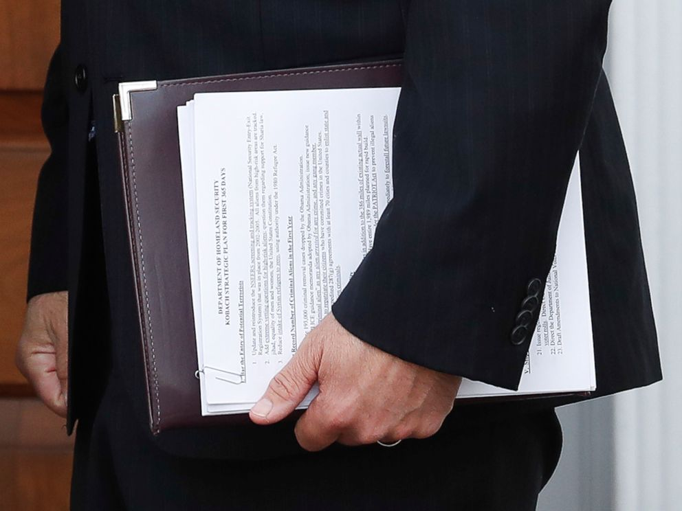 PHOTO: In this Nov. 20, 2016, photo, Kansas Secretary of State Kris Kobach holds a stack of papers as he prepares to meet with President-elect Donald Trump at the Trump National Golf Club Bedminster clubhouse, Nov. 20, 2016, in Bedminster, New Jersey.