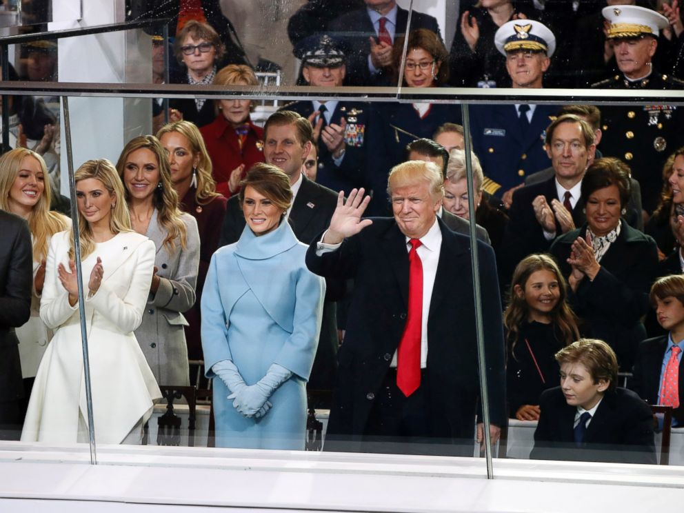 PHOTO: President Donald Trump waves as he is joined by First Lady Melania Trump and his family to view the presidential inauguration parade in Washington, Jan. 20, 2017.