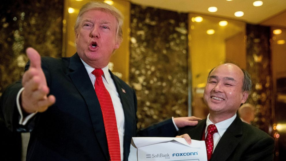 PHOTO: Donald Trump, accompanied by SoftBank CEO Masayoshi Son, speaks to members of the media at Trump Tower in New York, Dec. 6, 2016.