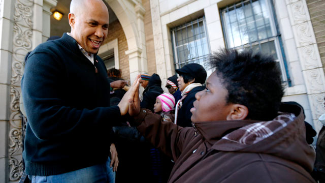 PHOTO: In this Nov. 9, 2012 file photo, Newark Mayor Cory Booker, left, greets 13-year-old Blonbzell Taylor outside of Clinton Hill Community Resource Center; on Nov. 29, 2012, Booker said he will live on food stamps for a week starting on Dec. 4, 2012, h