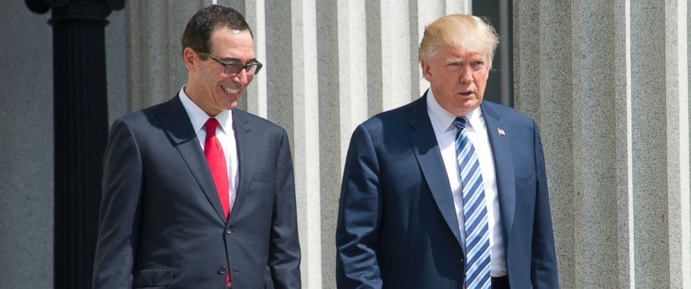 PHOTO: President Donald J. Trump and US Secretary of the Treasury Steven Mnuchin walk back to the White House after the President signed Executive Orders concerning financial services at the Department of the Treasury in Washington, DC on April 21, 2017.