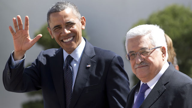 PHOTO: President Barack Obama waves to media as he walks with Palestinian President Mahmoud Abbas, right, as he arrives at the Muqata Presidential Compound Thursday, March 21, 2013, in the West Bank town of Ramallah.