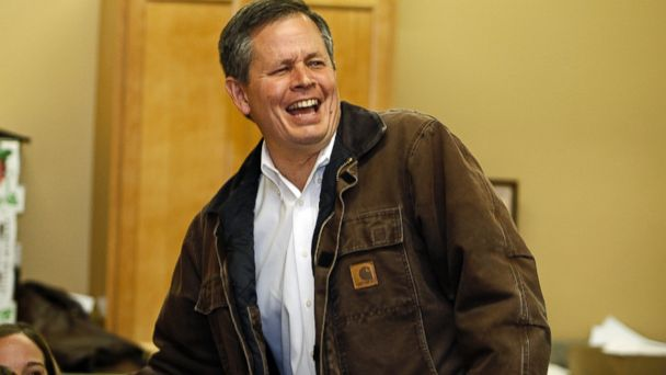 PHOTO: Montana Republican Senate candidate Rep. Steve Daines laughs with volunteers inside his election headquarters in Bozeman, Mont., Nov. 4, 2014.