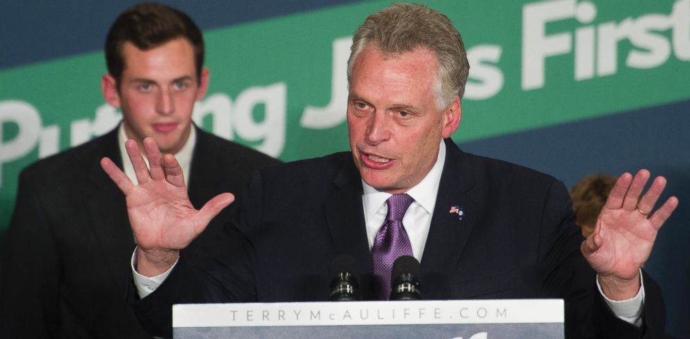 PHOTO: With his son Jack, 20, looking on, Democratic Virginia Gov.-elect Terry McAuliffe addresses supporters during his election victory party in Tysons Corner, Va., Tuesday, Nov. 5, 2013.
