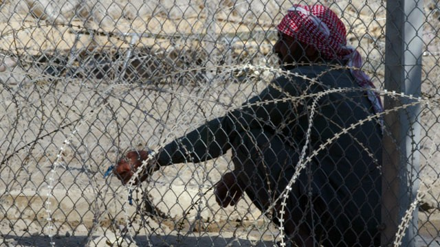 PHOTO: A prisoner holds on to his prayer beads  at Abu Ghraib prison, on the outskirts of Baghdad, Iraq, Aug. 1, 2004.