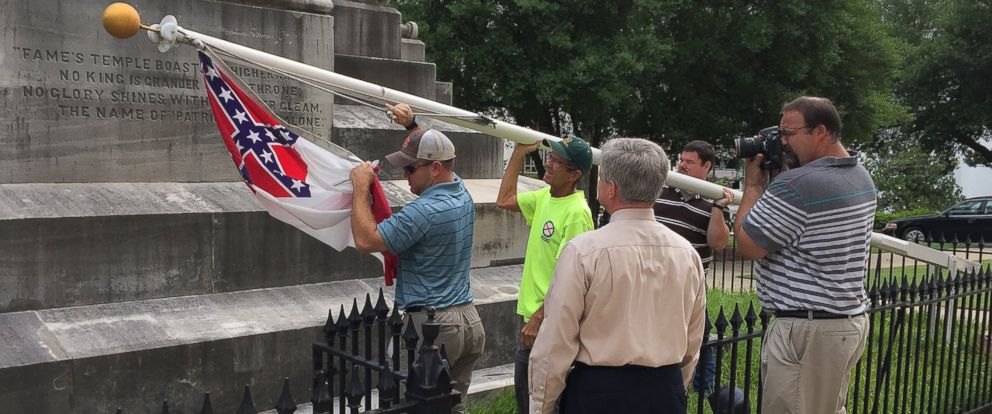 PHOTO: State workers take down a Confederate national flag on the grounds of the state Capitol, June 24, 2015, in Montgomery, Ala.