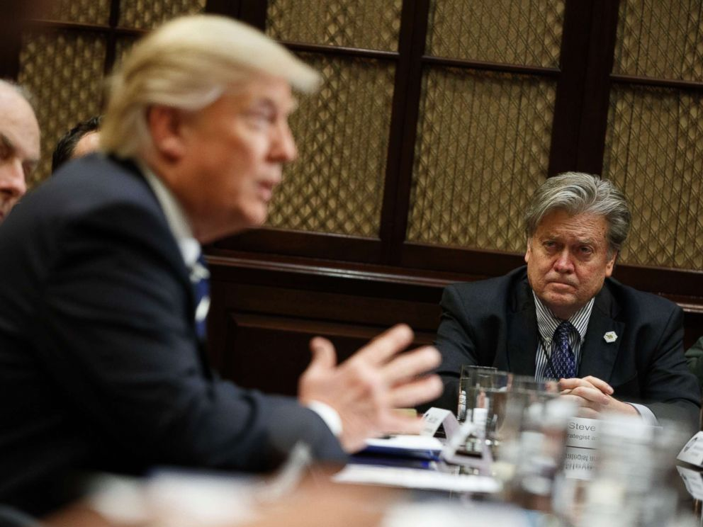 PHOTO: White House Chief Strategist Steve Bannon listens at right as President Donald Trump speaks during a meeting on cyber security in the Roosevelt Room of the White House in Washington, Tuesday, Jan. 31, 2017.