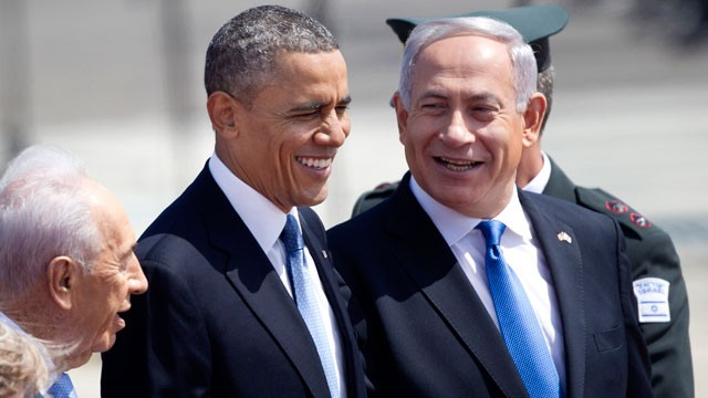 PHOTO: US President Barack Obama, and Israel's prime minister Benjamin Netanyahu, right, laugh as they walk during a welcoming ceremony upon Obama's arrival at Ben Gurion airport near Tel Aviv, Israel, March 20, 2013.