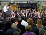 PHOTO: Barack Obama speaks to workers and guests