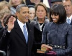 PHOTO: President Barack Obama receives the oath of office from Chief Justice John Roberts as first lady Michelle Obamas and his daughters look at the U.S. Capitol during the 57th Presidential Inauguration in Washington, Jan. 21, 2013.
