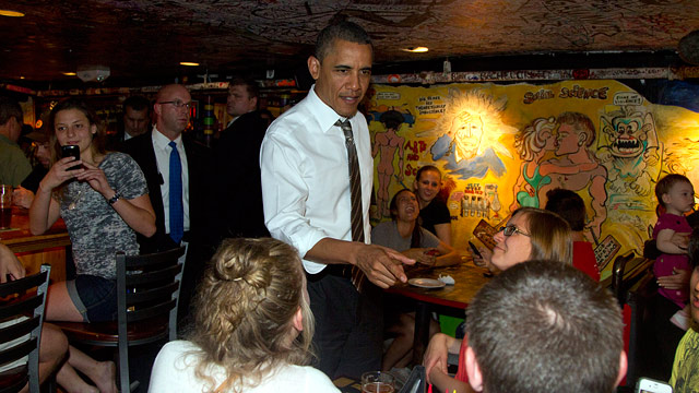 PHOTO: President Barack Obama greets people at The Sink Restaurant and Bar, Tuesday, April 24, 2012, in Boulder, Colo.