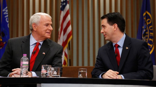 Republican Wisconsin Gov. Scott Walker, right, and Democratic challenger Tom Barrett look at one another as they get ready to participate in a televised debate.