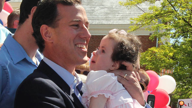 PHOTO: Former Pennsylvania Sen. Rick Santorum holds his daughter Isabella before announcing he is entering the Republican presidential race, June 6, 2011 in Somerset, Pa.