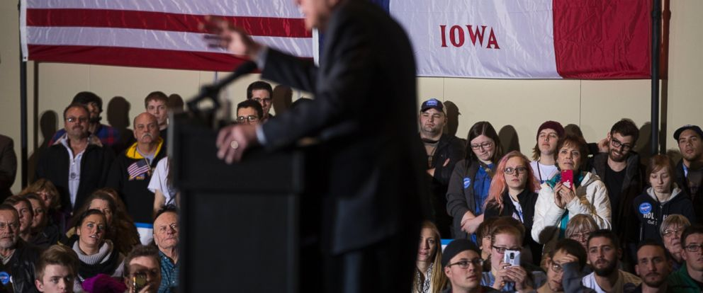 PHOTO: People look on as Democratic presidential candidate Sen. Bernie Sanders speaks during a campaign rally at Grand River Event Center, Jan. 29, 2016, in Dubuque, Iowa.