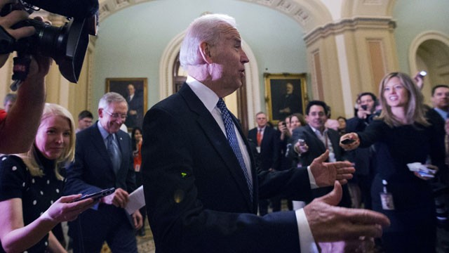 PHOTO:&nbsp;Vice President Joe Biden, center, with Majority Leader Harry Reid, left, of Nevada, arrive for a Senate Democratic caucus meeting about the fiscal cliff, on Capitol Hill Monday, Dec. 31, 2012.
