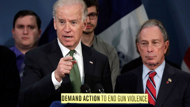 PHOTO: Vice President Joe Biden, left, accompanied by New York Mayor Michael Bloomberg, speaks in favor of an assault weapons ban in New York's City Hall Blue Room on March 21, 2013 as  relatives of shooting victims from Newtown, Conn., stood behind them.