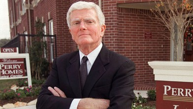 PHOTO: In this file photo, Houston homebuilder Bob Perry poses for photographers at the sales center of one of his Houston developments.