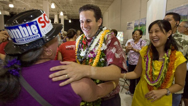 PHOTO: A supporter congratulates then-Lt. governor-elect Brian Schatz, center, as his wife Linda looks on at the Neil Abercrombie-Brian Schatz Hawaii governor's post election party in Honolulu, Nov. 3, 2010. Schatz was appointed by Gov. Neil Abercrombie,