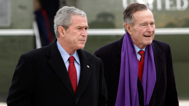 PHOTO: Former President George W. Bush walks with his father, former President George H.W. Bush, at Andrews Air Force Base, Md.