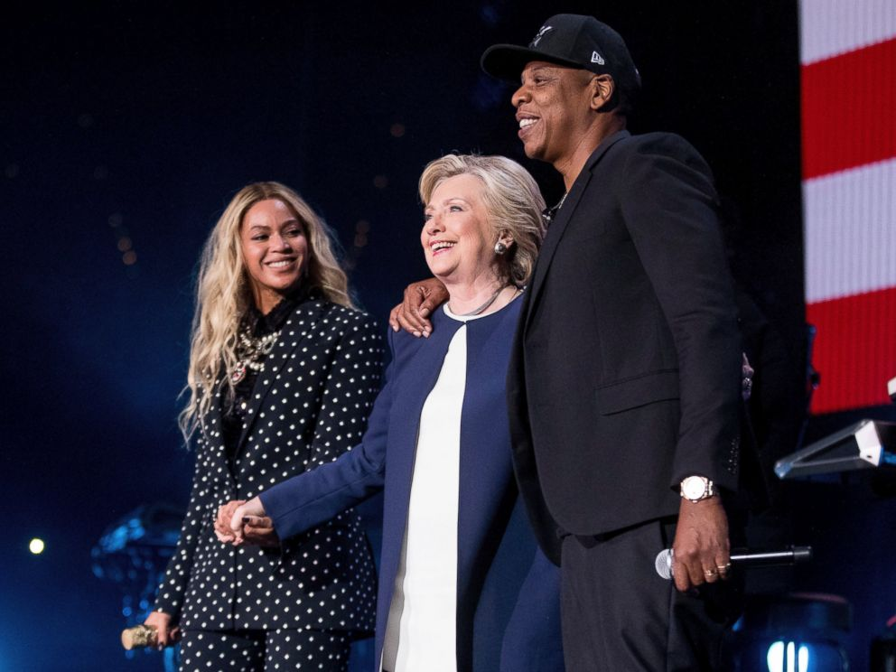 PHOTO: Democratic presidential candidate Hillary Clinton, center, appears on stage with artists Jay Z, right, and Beyonce, left, during a free concert at at the Wolstein Center in Cleveland, Friday, Nov. 4, 2016.