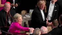 PHOTO: Hillary Clinton, second from left, and Donald Trump, right, greet guests at the end of the 71st annual Alfred E. Smith Memorial Foundation Dinner, Oct. 20, 2016, at the Waldorf Astoria hotel in New York.