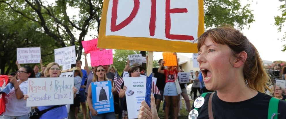 PHOTO: Protesters gather outside a Sen. Ted Cruz town hall meeting, Thursday, July 6, 2017, in Austin, Texas.