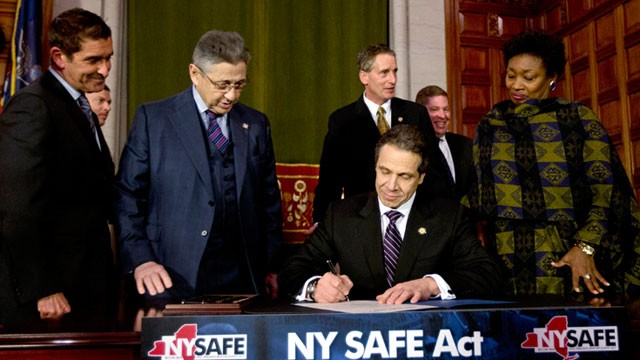 PHOTO: New York Gov. Andrew Cuomo signs New York's Secure Ammunition and Firearms Enforcement Act into law during a ceremony in the Red Room at the Capitol, Jan. 15, 2013, in Albany, N.Y.